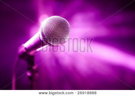 microphone on stage with purple background