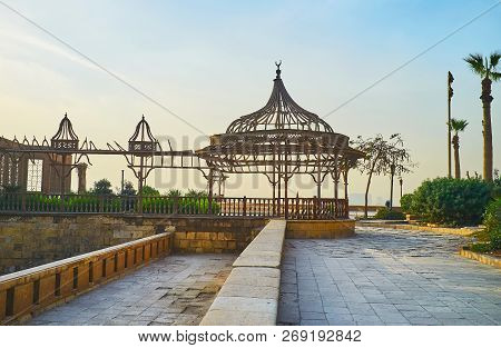 The Sunset Sky Behind The Scenic Wooden Porch Of Al-gawhara (bijou) Palace Of Sladin Citadel, Cairo,