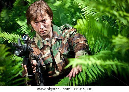 strike ball shooter holding a gun