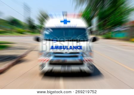 Looking From The Rearview Mirror Ambulance Speeding To Accident, Emergency Ambulance Travels Through