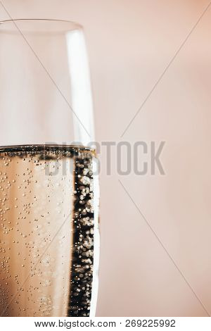One Glass Of Champagne On Light Background. Macro, Place For Text. Festive Concept.
