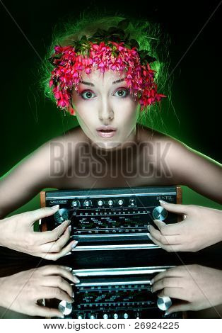 flower haired girl with colorfull make-up playing with retro radio , green natural funny