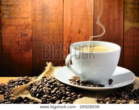 hot coffee with smoke on the grange background