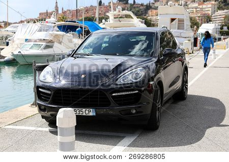 Menton, France - March 31, 2018: Luxury Porsche Cayenne Turbo Suv (front View) Parked On The Port Of
