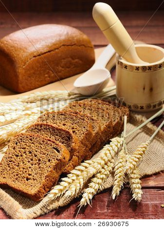 sliced bread and wheat on the wooden table