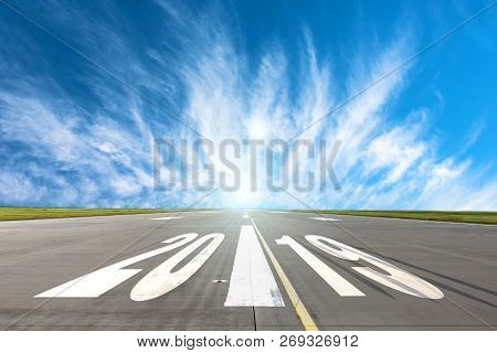 Runway Asphalt Road With The Inscription 2019 Year With A Beautiful Sky. The Concept Of The Beginnin