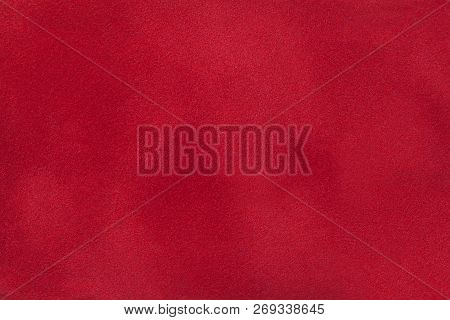 Dark Red Matte Background Of Suede Fabric, Closeup. Velvet Texture Of Seamless Wine Leather. Felt Ma