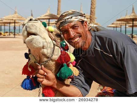Portrait of camel and his owner