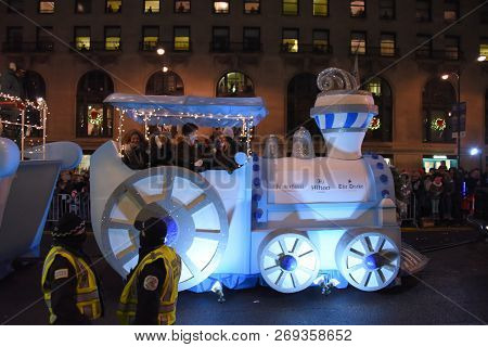 Festival Of Lights Parade, Hilton Hotel Blue And White Choo Choo Train Parade Float On Michigan Aven