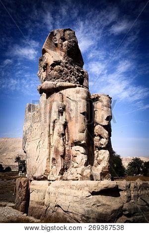 Colossi Of Memnon Next The City Of Luxor In Egypt.