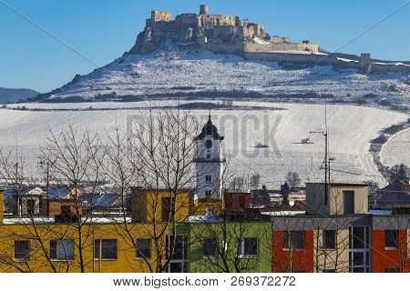 View Of The Snow-covered Spis Castle ( Spissky Hrad)  , The Largest Castle In Slovakia From The Town