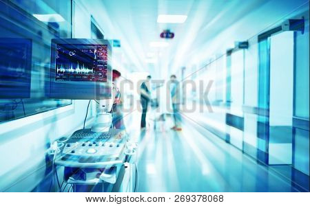 Utrasound Modern Machine With A Picture Of The Heart In The Corridor Of The Hospital With The Patien