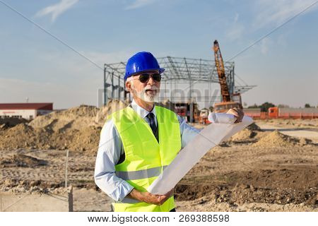Engineer Working At Building Site