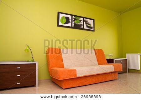 Orange sofa in modern bedroom