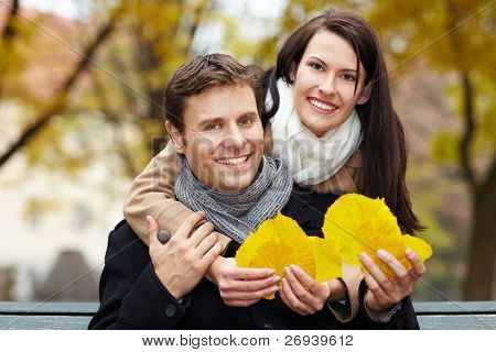 Couple Collecting Leaves