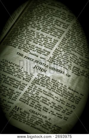 Bible Series. close up detail of antique holy bible open to the gospel according to the general epistle of john in the new testament finished in sepia poster
