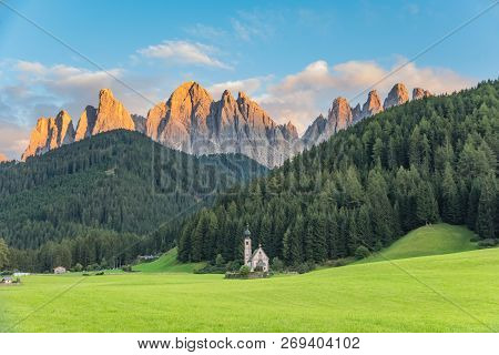 Wonderful Sunny Landscape Of Dolomite Alps. St Johann Church, Santa Maddalena, Val Di Funes, Dolomit