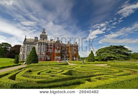 Adare manor in red ivy and gardens in Ireland