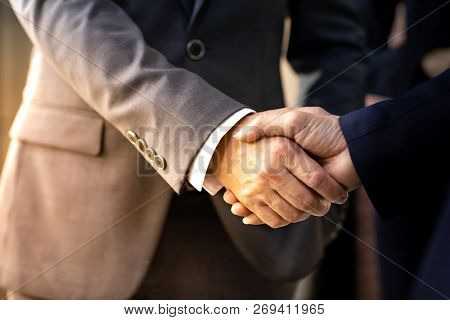 Handshake for Business deal Business Mergers and acquisitions Closeup