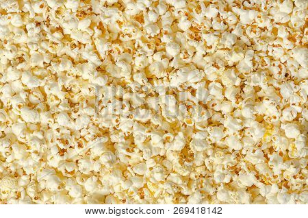Popcorn, Popped Corn, Surface And Background. Butterfly Shaped Popcorn Puffed Up From The Kernels, A