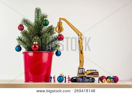 Miniature Workers Decorating Giant Christmas Tree. Macro Photo