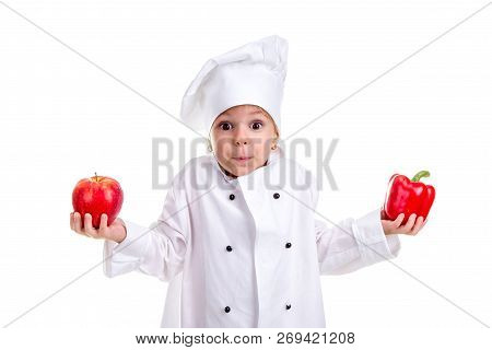 Hard To Make A Decision. Chef Girl In A Cap Cook Uniform With Both Arms Up, Holding Red Bell Pepper