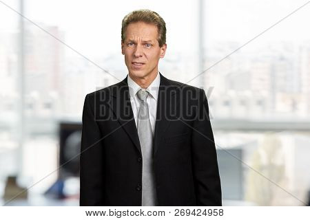 Portrait of startled speechless insulted man. Shocked businessman with frowning brows. Facial expression of dissapointment. poster