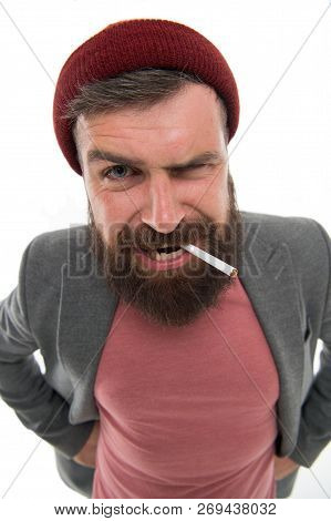 Brutal Unshaven Guy Smoking Isolated White Background. Man Brutal Bearded Hipster Bully Dressed As V