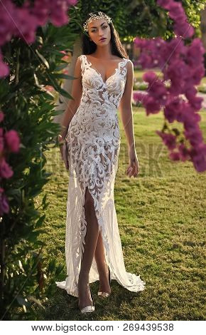 Woman In White Wedding Dress In Garden. Bride And Wedding Ceremony. Wedding Fashion And Beauty. Eleg