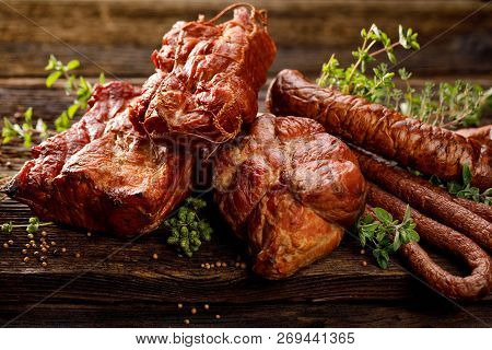 Smoked Meats And Sausages. A Set Of Traditional Smoked Meats And Sausages: Ham,gammon, Pork Loin, Ho