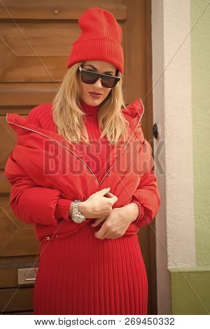 Girl In Fashionable Red Dress, Hat And Glasses, France. Woman With Blonde Hair, Urban Style. Look An