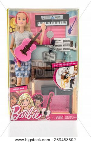 Winneconne, Wi - 4 November 2018: A Package Of Barbie As A Musician On An Isolated Background.