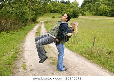 Mixed couple exercising outdoor