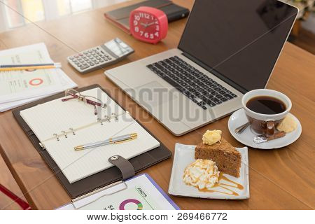 Business And Finance Concept Of Working, Working Desk In Coffee Shop With Dessert.