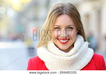 Front View Portrait Of A Happy Woman Looking At Camera In The City Street In Winter
