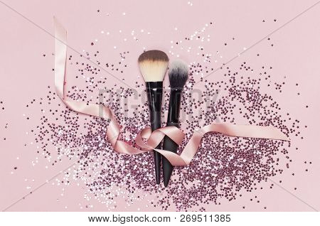Two Different Cosmetic Makeup Brushes With Pink Ribbon And Holographic Glitter Confetti In The Form