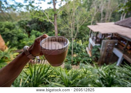 Hot Coffee In A Cup Was Holding By Left Hand In Front Of Landscape Mountain View, Traveling In Thail