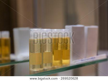 Hotel Amenities On Glass Shelf Near Mirror In Bathroom