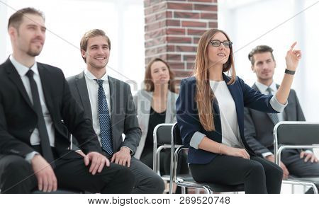 Interested woman asking for questions