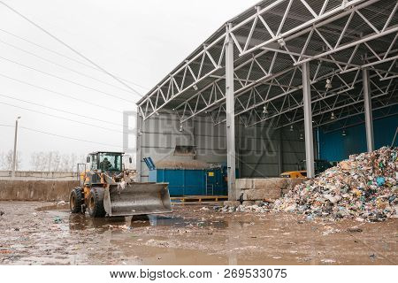Special Machinery Or Bulldozer Work On The Site Of Waste Unloading At The Plant For Waste Disposal.