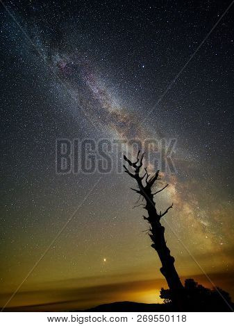 The Milky Way And Mars Rise. The Milky Way Clearly Seen On A Starry Night With Mars Rising Just Abov