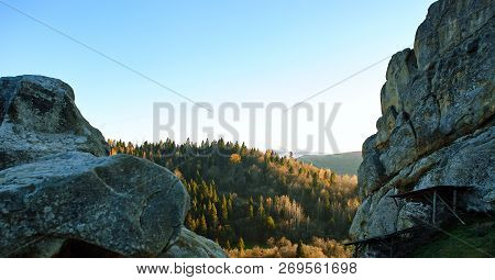 Sunrise In National Park Over Forest And Rocks. The Rising Sun Beautifully Illuminates The Tops Of T