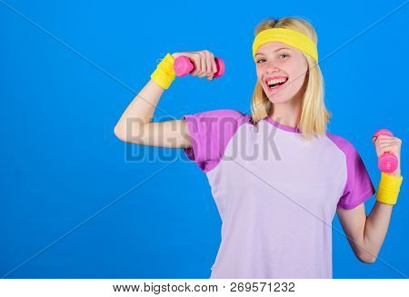 Girl Exercising With Dumbbell. Fitness Instructor Hold Little Dumbbell Blue Background. How To Get T
