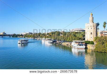 Spain, Andalusia, Seville, The Torre Del Oro (gold Tower) On The Guadalquivir River
