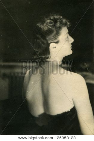 Vintage photo of young woman with decolletage (forties)