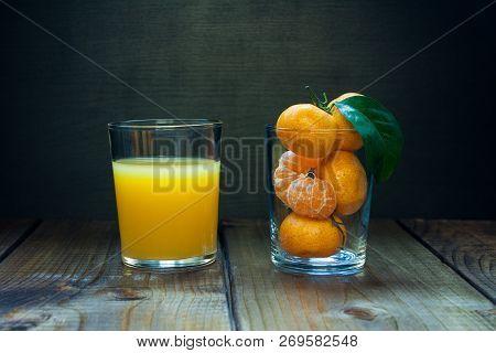 Orange Juice And Tangerines.