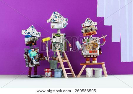 Professional Painter Decorators Team At Work. Funny Robots With Paint Rollers And Buckets, Purple Co