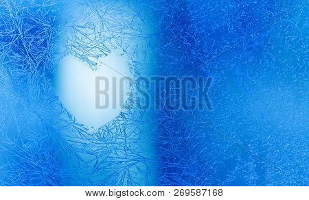 Christmas Love Heart Frozen Blue Window Background. Valentines Day Greeting Card With Love Shape Sym