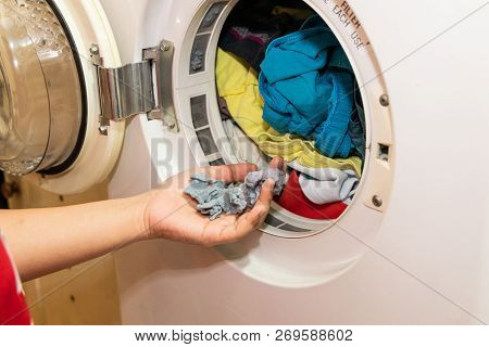 Handful Of Lint Trapped In Filter Of Laundry Dryer Machine