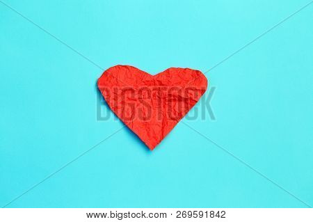 Red Crumpled Paper Hearts On Blue Background, Valentines Day Card. Symbol Of Medical Cardiovascular